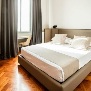letto-matrimoniale-guest-house-castello-dove-dormire-a-milano